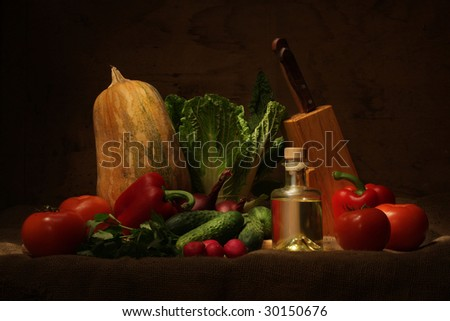 Vegetable still life with knife and oil bottle