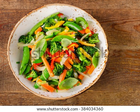 Vegetable stir fry in a plate. Top view - stock photo