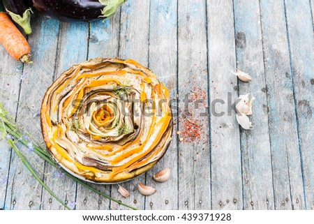 Vegetable tart of carrots,zucchini and eggplant - stock photo