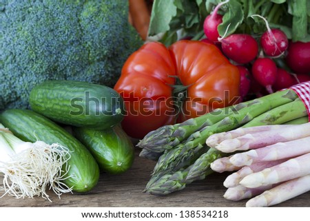 Vegetables and asparagus from the market on a rustic wooden background