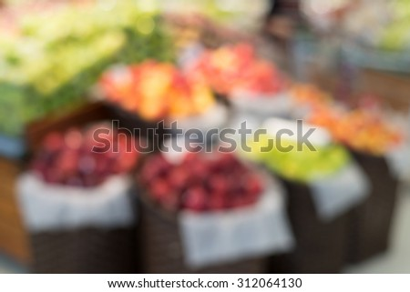 Vegetables and fruit section in supermarket blurred background