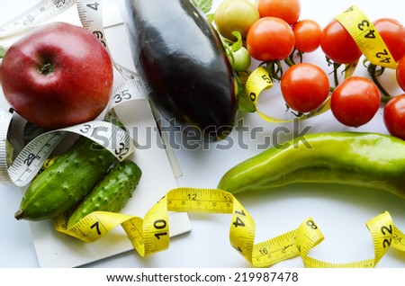 vegetables and fruits for weight loss, a measuring tape, diet,