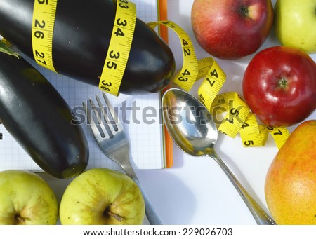 vegetables and fruits for weight loss, a measuring tape, diet, weight loss, measuring tape, healthy eating, healthy lifestyle concept.Notepad,diary,eggplant,Apple,pear