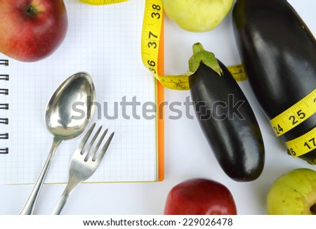 vegetables and fruits for weight loss, weight loss, measuring tape, healthy eating, healthy lifestyle concept.Notepad,diary,eggplant,Apple,pear - stock photo