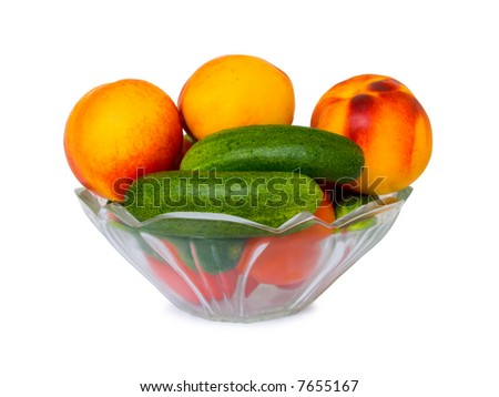 Vegetables and fruits in bowl, isolated on white background - stock photo