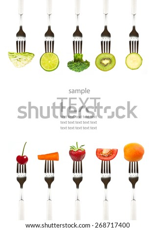 vegetables and fruits on the collection of forks, diet concept - stock photo
