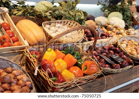 Vegetables and groceries on stall in a supermarket - stock photo