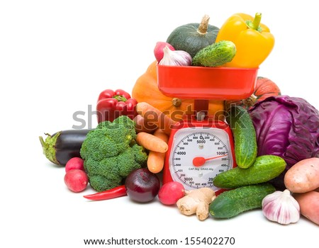 vegetables and kitchen scales closeup on a white background. horizontal photo - stock photo