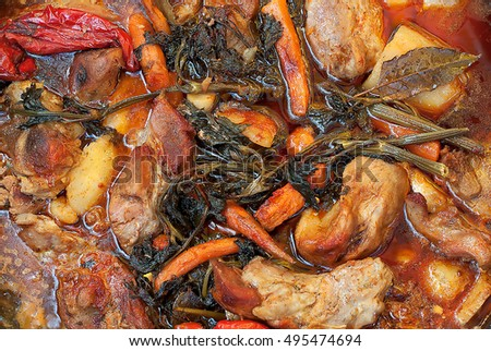 Vegetables and meat cooked in a pot of soil
