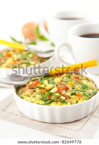 Vegetables and Meat Quiche with Spinach Served for Breakfast with Coffee - stock photo