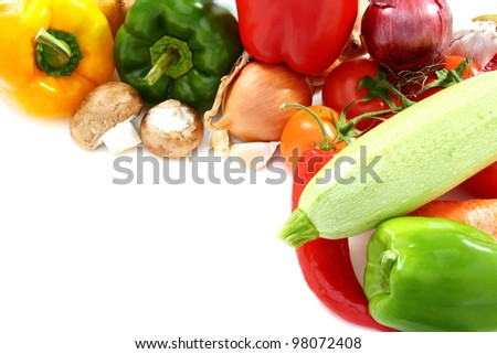 Vegetables and mushrooms on a white background.