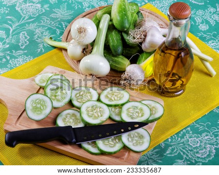 Vegetables and olive oil on a table