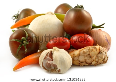 Vegetables and spices on a white background close-up - stock photo