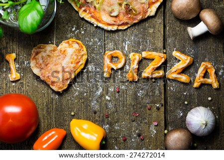 Vegetables and spices on wood, I love pizza - stock photo