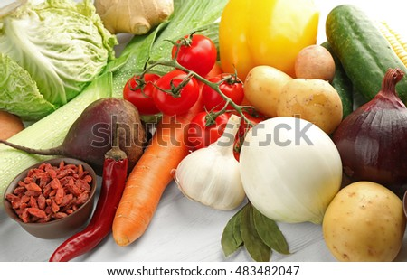 Vegetables and spices on wooden table, closeup