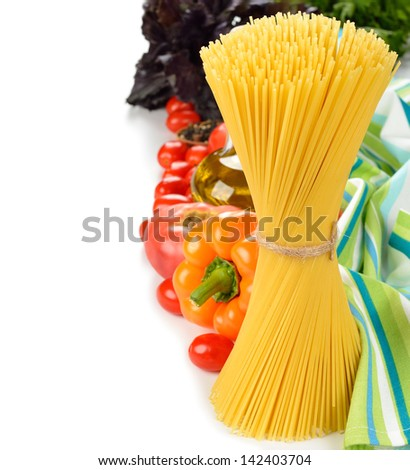 Vegetables and uncooked pasta on a white background