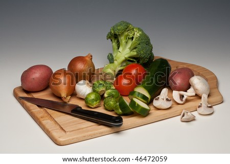Vegetables being prepared on a chopping board