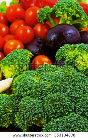 Vegetables: broccoli, peeled raw potatoes, peeled boiled beets, red peppers, cherry tomatoes - stock photo
