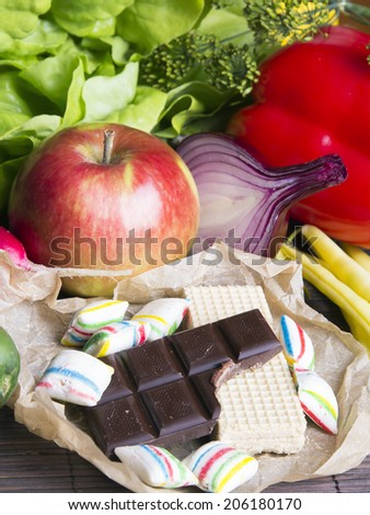 vegetables, candy and chocolate  - stock photo