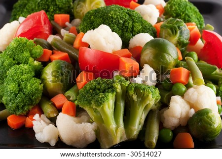 Vegetables: cauliflower, brussels sprouts, broccoli, carrots, string beans  and tomatoes