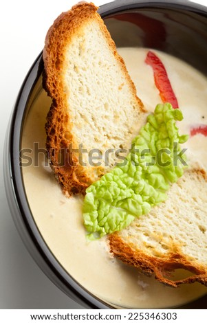 Vegetables Cream Soup. Garnished with Bread and Herbs