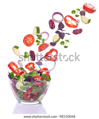 Vegetables for a salad of lettuce falling. Isolated on white. - stock photo