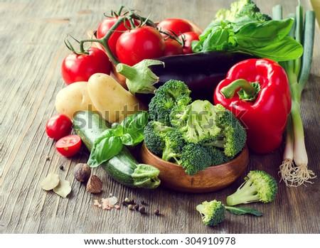 Vegetables for cooking healthy dinner, kitchen table, vegetarian food, fresh ingredients - stock photo