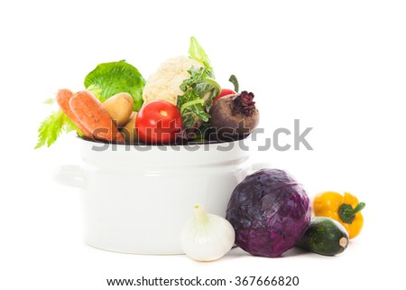 Vegetables for soup in pan isolated on white - stock photo