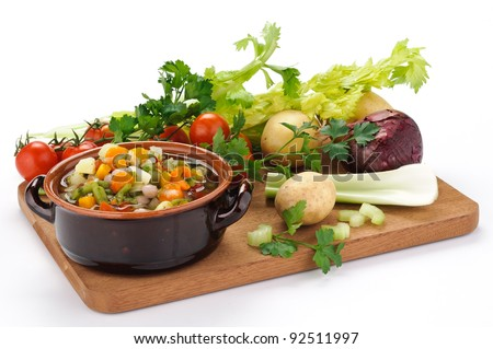Vegetables for vegetable soup on a cutting board - stock photo