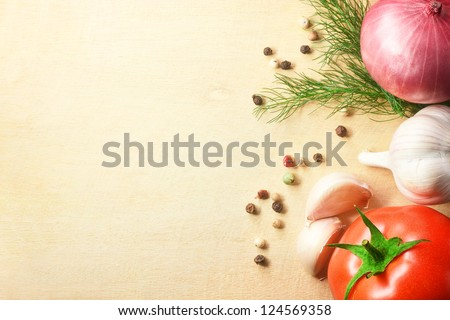 vegetables fresh tomato with onion, garlic and spices on cutting board - stock photo