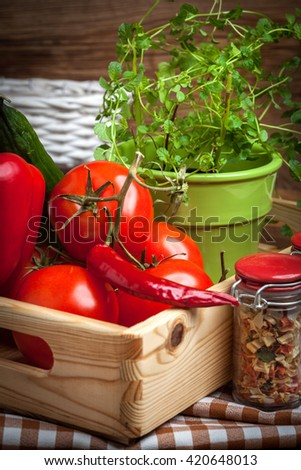 Vegetables from the home garden in a wooden box.