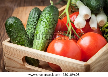 Vegetables from the home garden in a wooden box. Selective focus.