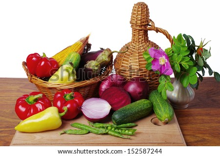 Vegetables, grapes and flowers. Isolated on white     - stock photo