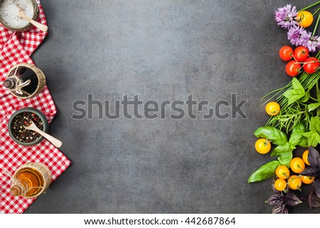 Vegetables, herbs and spices on black ceramic table, top view, copy space, rustic style. Vegetarian food, health or cooking concept.  - stock photo