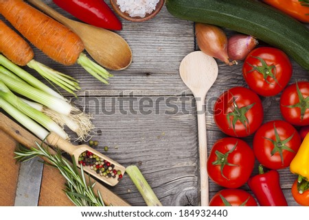 Vegetables, herbs and spices on wooden board