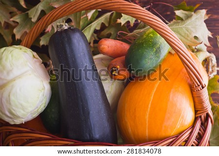 Vegetables in a basket among the autumn leaves