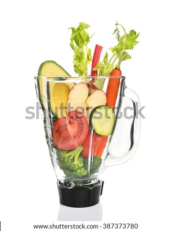 Vegetables in a blender ready for juicing. Healthy eating concept. - stock photo