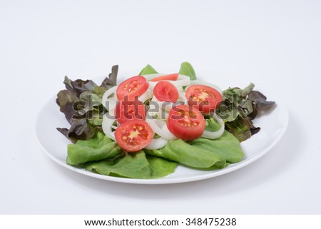 Vegetables in a dish on a white background.