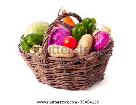 vegetables in basket isolated on white