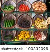 Vegetables in baskets on market place. - stock photo