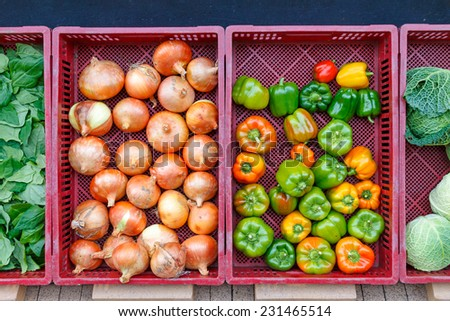 Vegetables in containers in front of the grocery store in autumn - stock photo