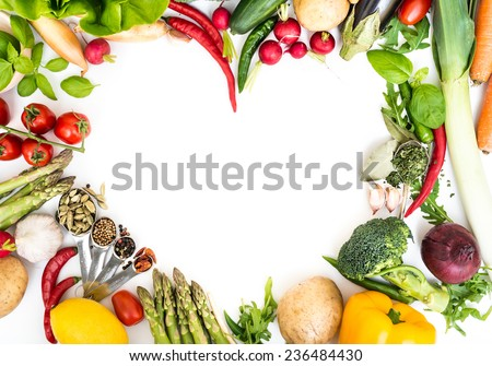 Vegetables in heart shape on a white background - stock photo