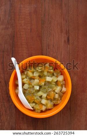 vegetables in orange bowl - stock photo