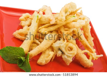 vegetables in tempura on red plate