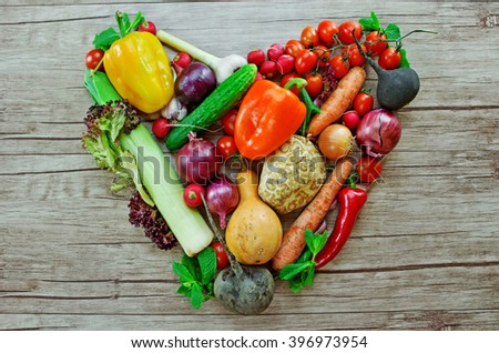 vegetables in the shape of heart  on wooden desk - stock photo