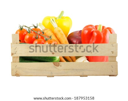 Vegetables in wooden box isolated on white