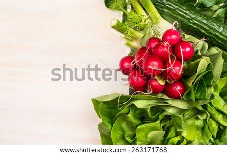 Vegetables ingredients for salad: radish, cucumber,lettuce on white wooden background, top view,place for text - stock photo