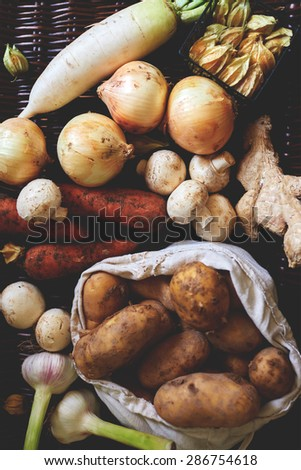Vegetables lie on a dark textural table, Freshly harvested vegetables from the garden, non-GMO - stock photo