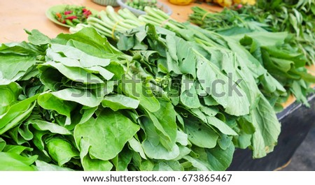 Vegetables mustard in closed-up view on the table for sell at morning market.