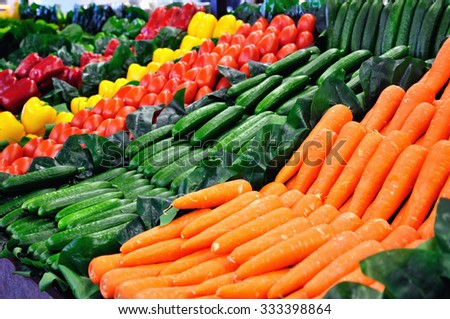 Vegetables on a shelf at the supermarket - stock photo